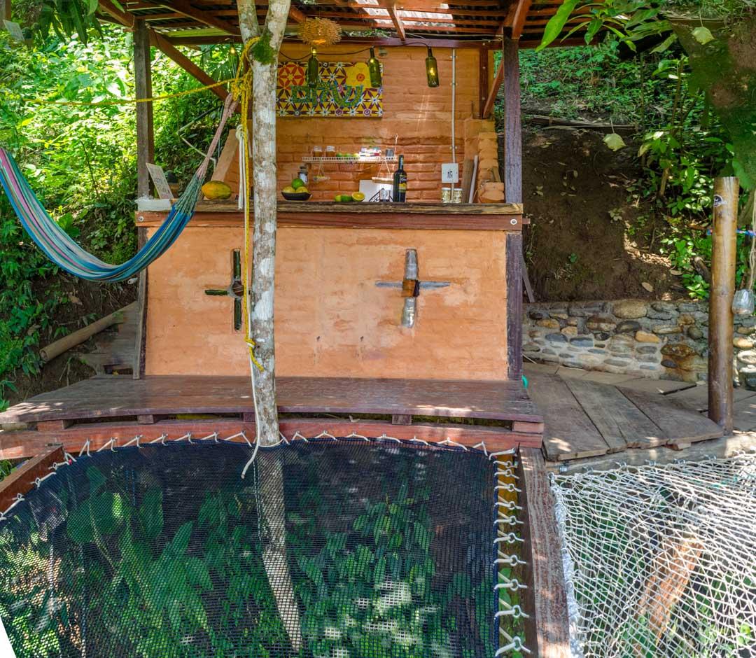 Hostal Colibri Minca/Colombia - Nuestros Cabañas - El Nidito - Hamaca y Cocina